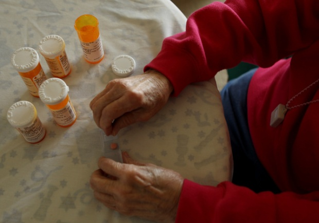 Inez Willis sorts her daily medical prescriptions at her independent living apartment in Maryland