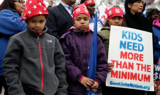 Children of low wage U.S. federal contract workers attend a strike rally in Washington
