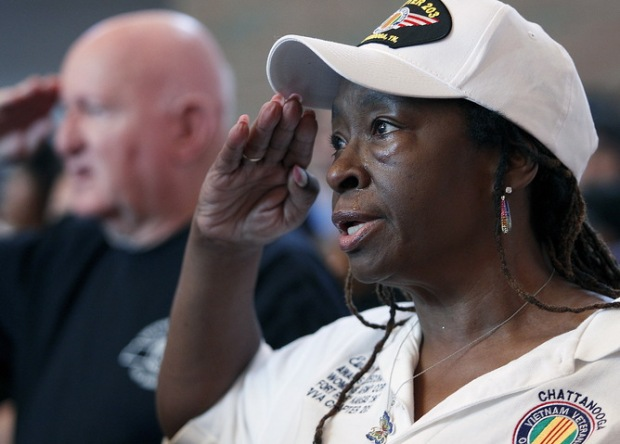 Shropshire sheds a tear as she salutes during the national anthem at an interfaith vigil for the victims of the Tennessee shooting, at Olivet Baptist church in Chattanooga