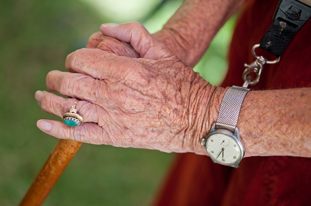 Close up of senior woman's hands holding walking stick