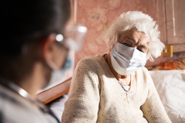 Coronavirus protection. Female doctor home visit during the quarantine.